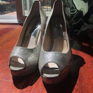 Micheal Kors size 9 silver heel